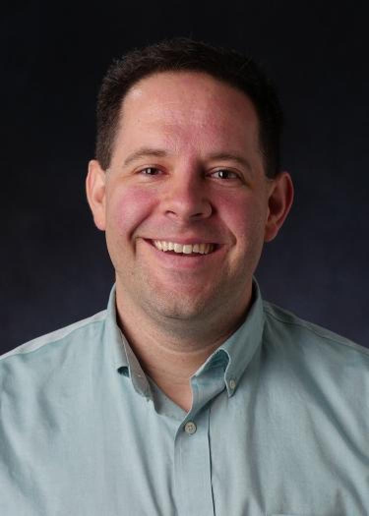 Headshot of CU Boulder's Leeds School of Business associate professor Tony Cookson.