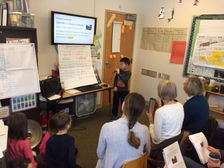A student presents design ideas.