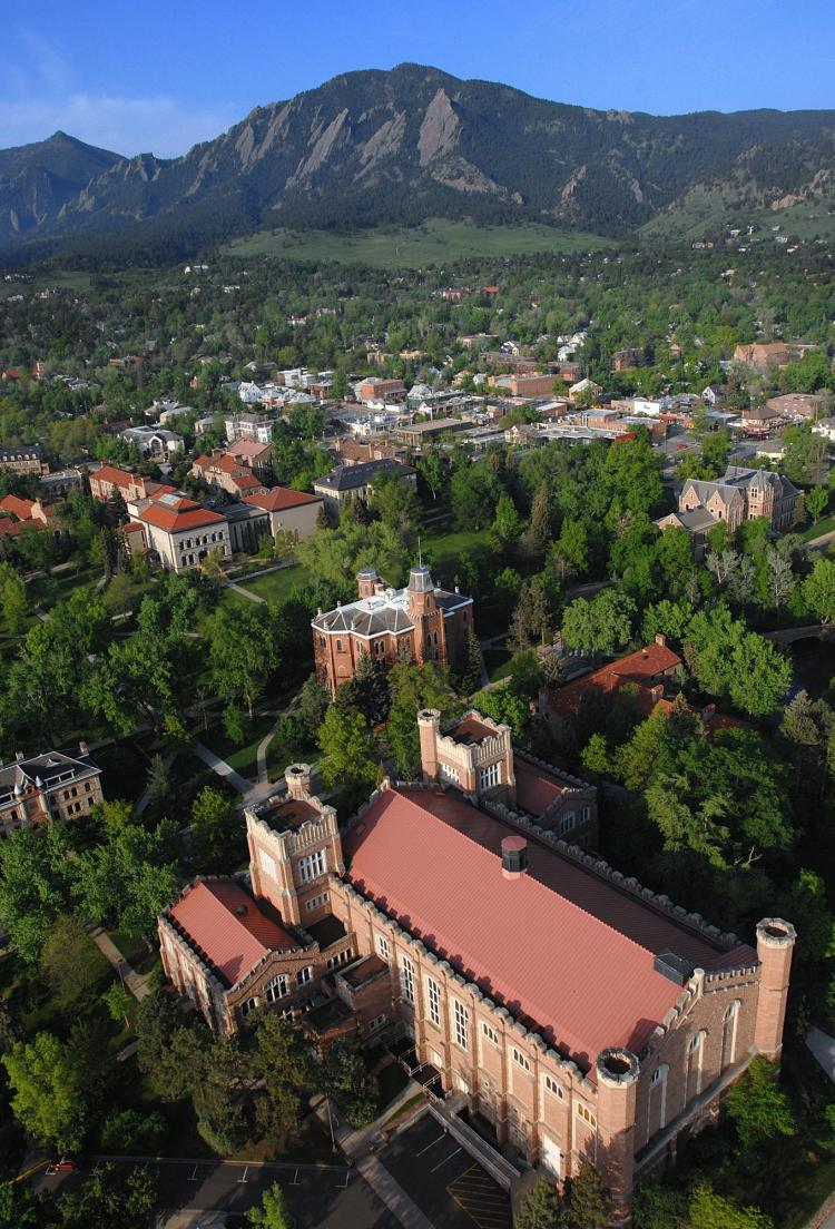 An aerial view of the CU Boulder campus shows Macky Auditorium in the lower-right corner.
