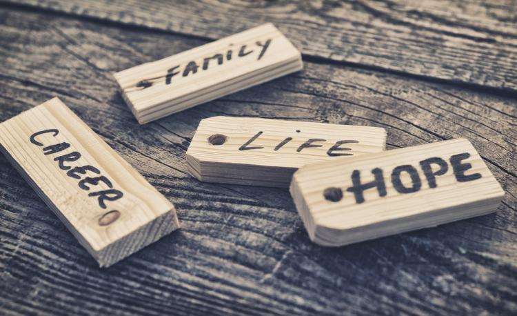 Pieces of wood read: Career, family, life, hope