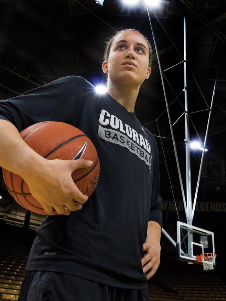 Haley Smith poses with basketball in hand on court