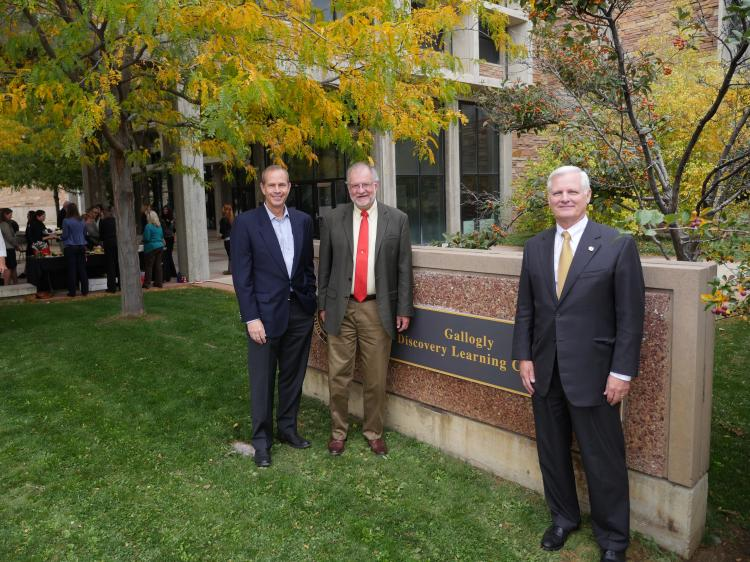 Jim Gallogly, CU Engineering School alumnus, CEO of LyondellBasell Industries and member of the CU Engineering Advisory Council, right, is photographed with  CU Engineering Dean Rob Davis, center, and Mike Wirth, a Chevron corp. VP and chair of the CU Engineering Advisory Council after unveiling a temporary sign showing the new name for the Discovery Learning Center.