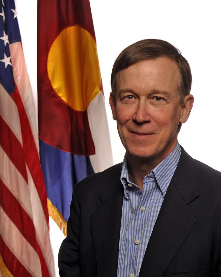 Governor John Hickenlooper with flags