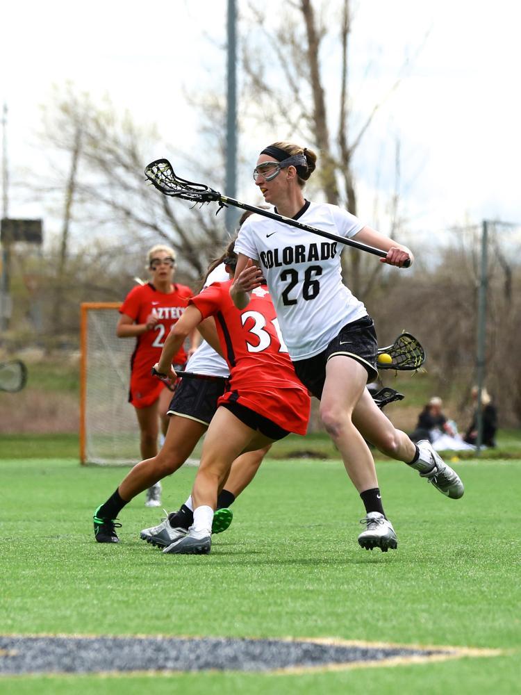 Maddie DeWinter on field during lacrosse game