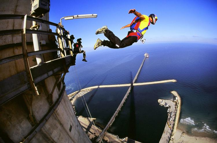Man BASE jumping off a building