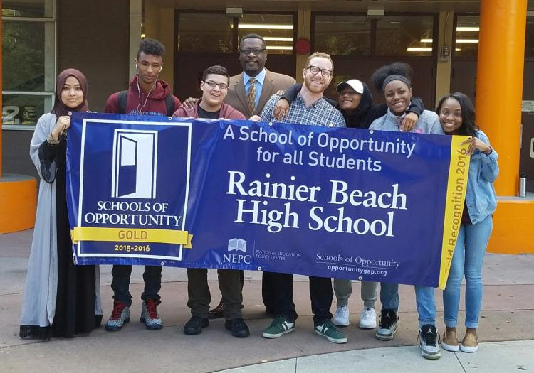 Students at Rainier High School holding a recognition banner