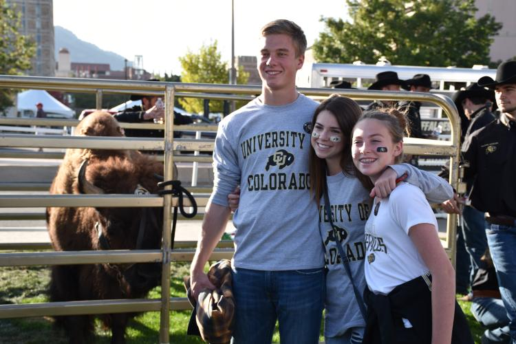 Buffs fans standing next to Ralphie the Buffalo