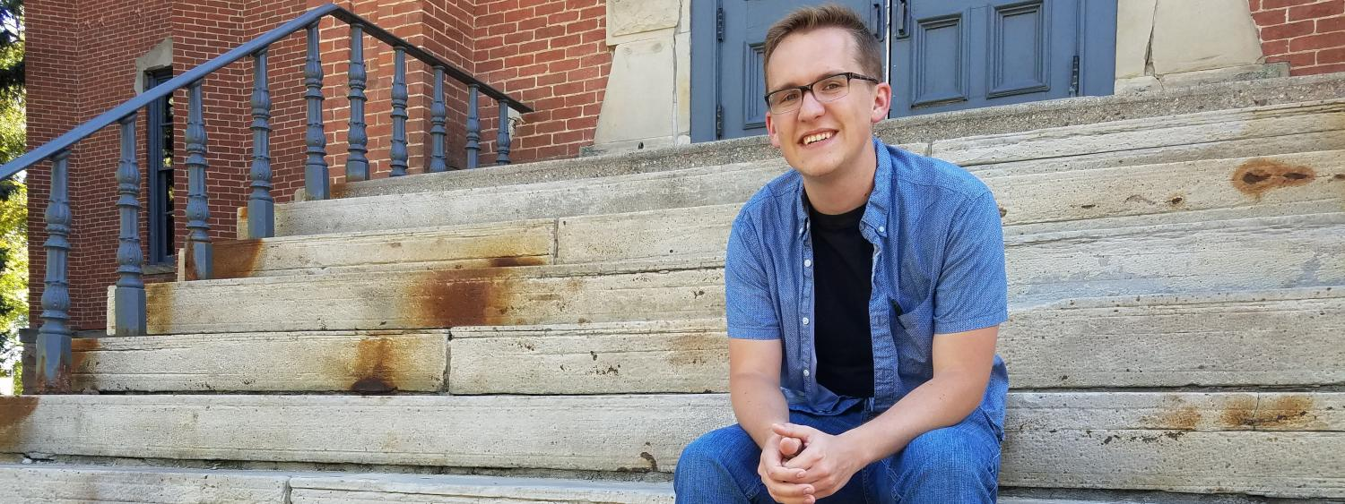 Austin Braun on the steps of Old Main