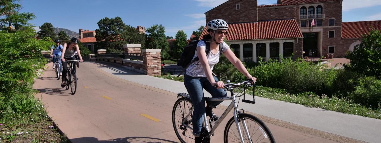 CU employee bikes to work along the creek path