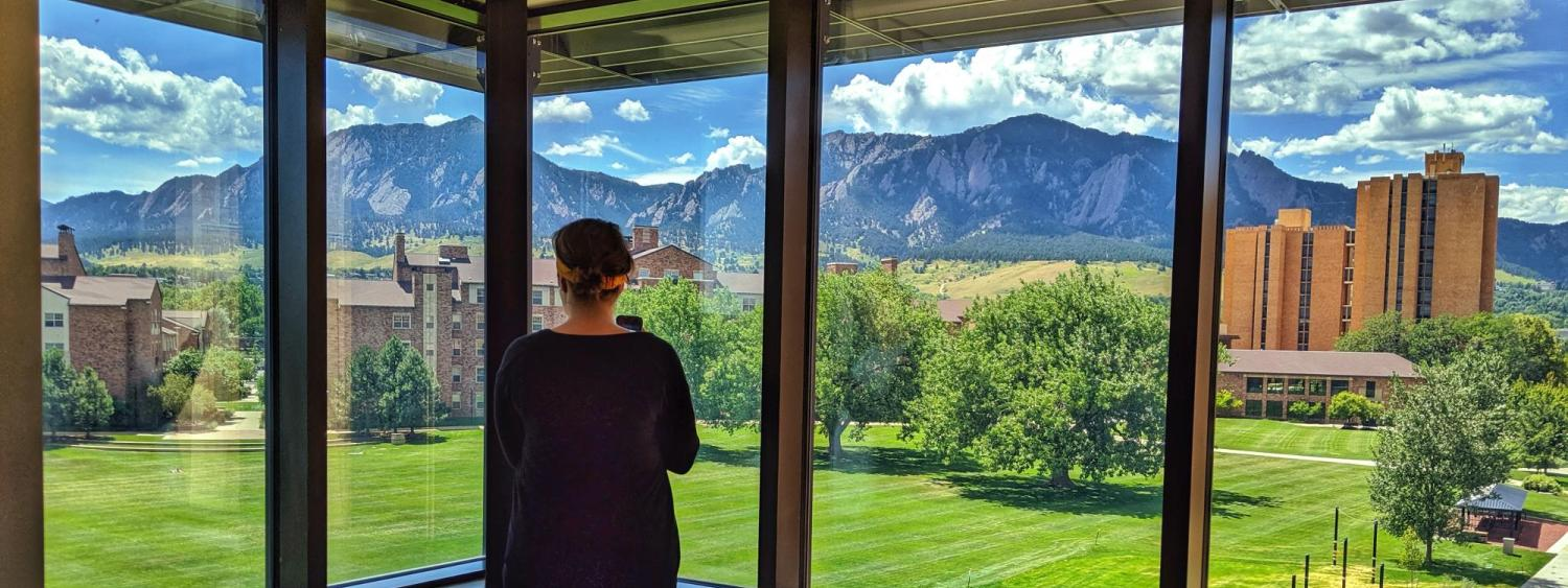 A view from Williams Village East of the Flatirons