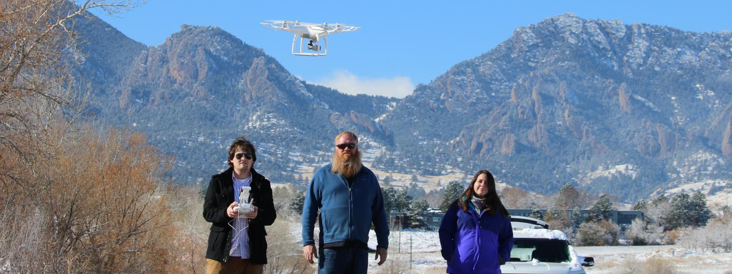 researchers flying a drone