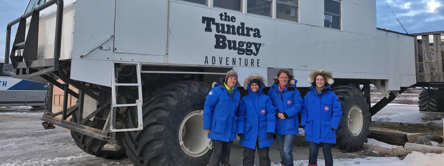 Students pose in front of the Arctic Tundra Buggy