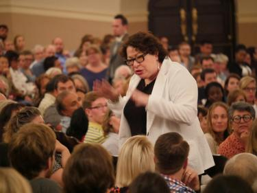 Justice Sonia Sotomayor walks through the aisles while addressing the crowd.