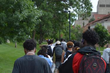 Participants in the boys2MEN Leadership Summit walk through campus