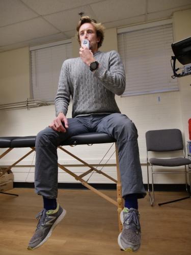 Tom Heinbockel demonstrating using a Power Breathe device