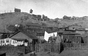 Image of homes in the Salt Creek neighborhood of Pueblo around 1906, the area where many Latino workers lived. (Photo courtesy of Steelworks Center of the West, Pueblo. Originally in Camp and Plant, CF&I paper, Vol. 4, No. 11.)