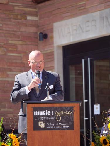CU Boulder College of Music Dean John Davis addresses campus, CU system and College of Music faculty, leadership, guests, donors, alumni and other dignitaries gather for the official ribbon cutting and opening of the Warner Imig Music building expansion on Sept. 17, 2021. (Photo by Glenn Asakawa/University of Colorado)