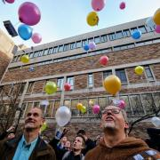 Pathways to Space class students release balloons at the end of their kickoff class outside of Meunzinger Auditorium.
