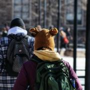 An unidentified Buff sports a cap of a different animal on the way to class on a chilly Friday morning.