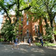 Students walk past Old Main on the first day of classes for the fall 2018 semester