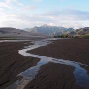 A mostly dry river bed in the Rocky Mountains