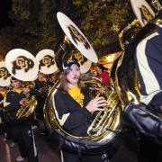 The CU marching band plays at the Homecoming parade