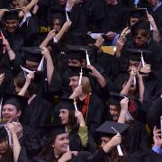 Graduates move their tassels, signifying their entry into the company of scholars