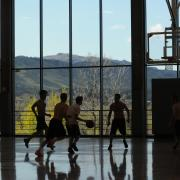 Students play basketball in the Rec Center gym
