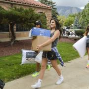 Students helping during move in day