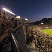 Night-time football game at Folsom Field