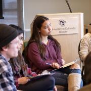 Students listen at workshop session