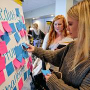 Participants map out challenges with sticky notes at the fall 2017 summit