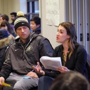 Participants dialogue at university event