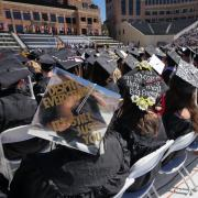 Graduates sit in rows at commencement ceremony