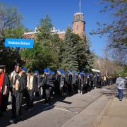 PhD candidates on the way to commencement