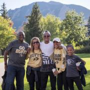 Family poses for photo on campus during annual Family Weekend