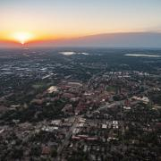 Aerial view of CU Boulder and the city