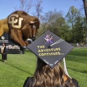 Student graduation cap reading 'The adventure continues'