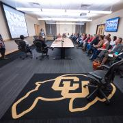 CU Buff rug in focus during a Diversity and Inclusion Summit session