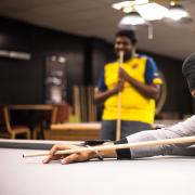 students playing billiards in The Connection
