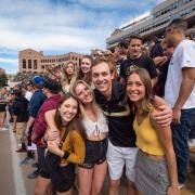 Students pose for photo at 2018 homecoming game