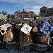 Decorated graduation caps during ceremony
