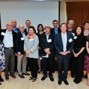 Members of the Boulder Faculty Assembly pose for a photo at an excellence awards ceremony.