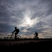 Silhouettes of cyclists commuting to work