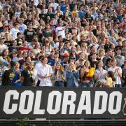 Fans cheer on the Buffs in a packed Folsom Field stadium