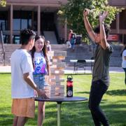 Students play with giant Jenga blocks during CU Unity Fair