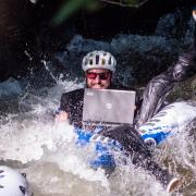 Man participates in Tube to Work Day in Boulder.