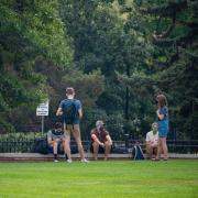students outside in a group of six people