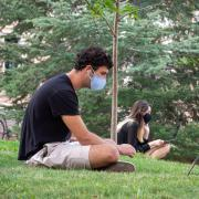 Students, staff and faculty, all wearing facial coverings and practicing proper social distancing protocols, participate in classes and study on the first day of the 2020 Fall semester on the CU Boulder Campus. (Photo by Glenn Asakawa/University of Colorado)