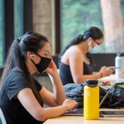 A student studying in the Engineering Center on the first day of the Fall 2020 semester. (Photo by Glenn Asakawa/University of Colorado)